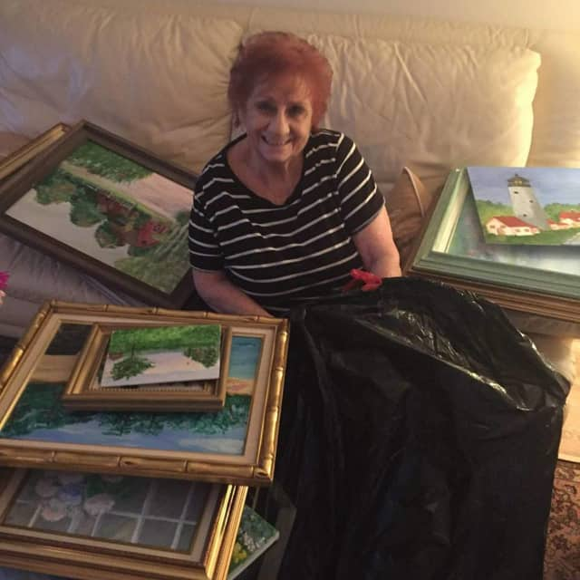 Ann Tomkins, of Moonachie, surrounded by some of her paintings.