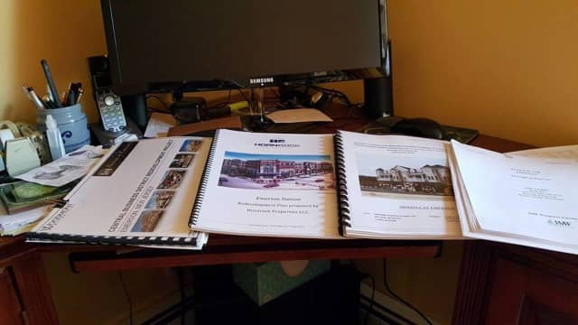 Emerson received four proposals – pictured here on Mayor Lou Lamatina's desk – for its Central Business District.