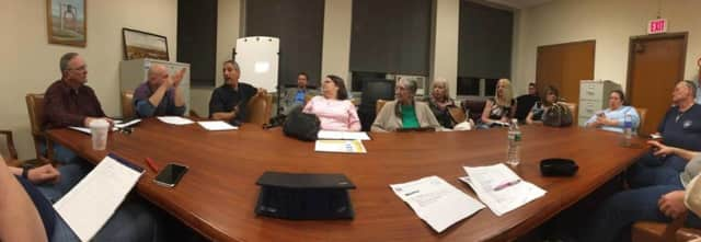 Board members plan the 150th Annual Carlstadt School Picnic on March 10.