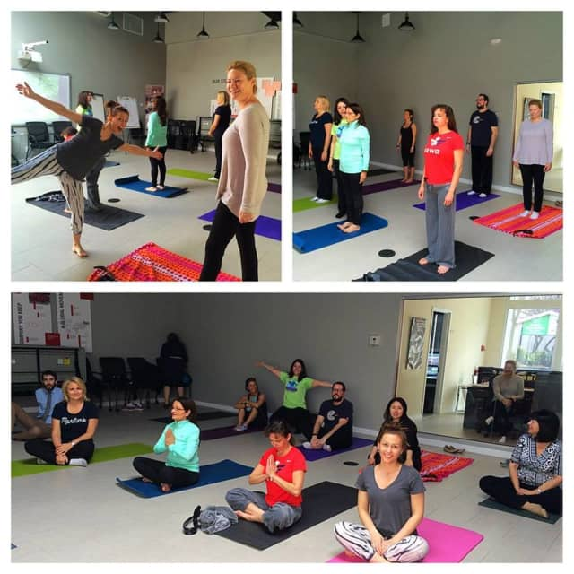 Keller Williams Tenafly employees get some time on their yoga mats at work.