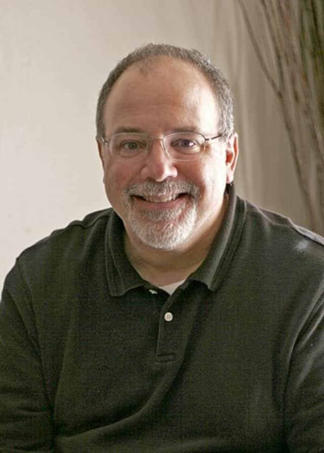 Photojournalist and lecturer Jim DelGiudice
