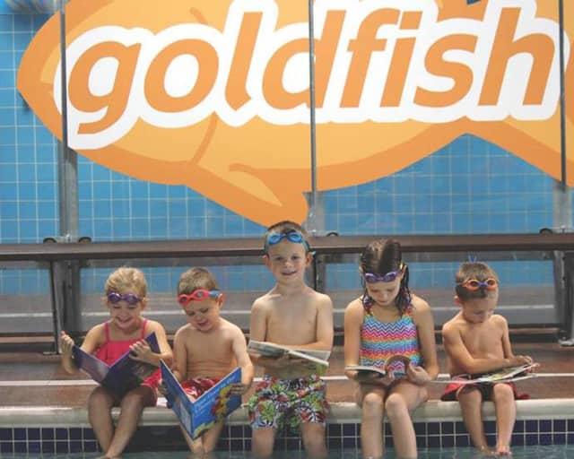 Kids read at Goldfish Swim School in Wyckoff.