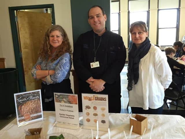 Pictured are volunteers Pascale LeDraoulec and Kati Princzinger with Chef Alan Levin.