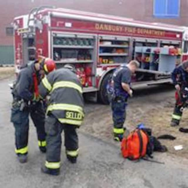 The Danbury firefighters were able to douse an earlier morning apartment fire on Bell's Lane before it spread to others units.
