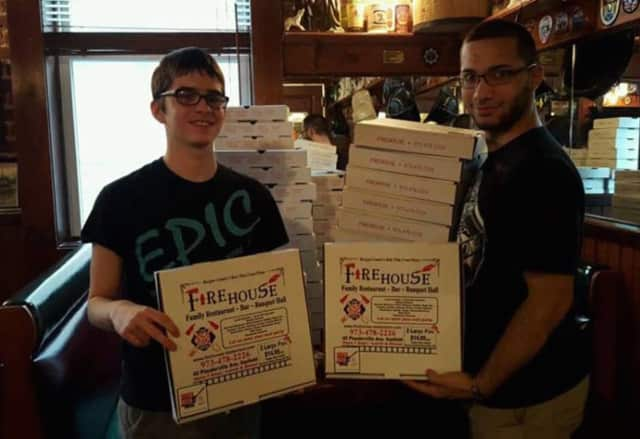 Garfield EPIC volunteers put awareness stickers on pizza boxes at Firehouse Family Restaurant.