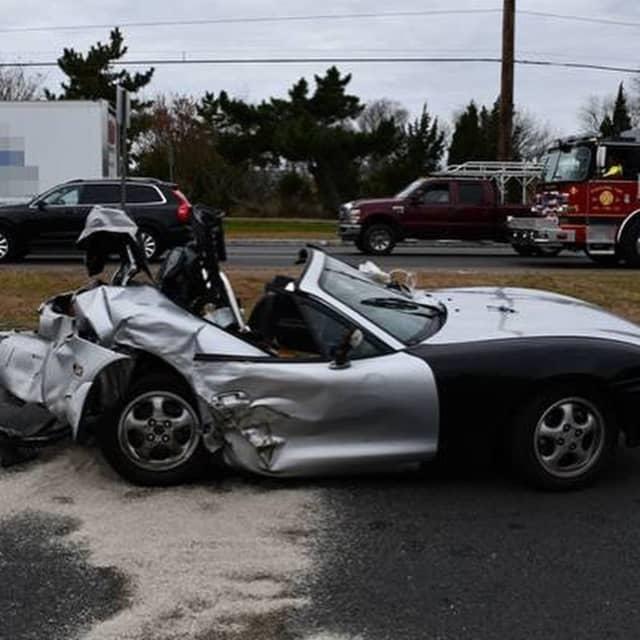 Mazda Miata damaged in the wreck.