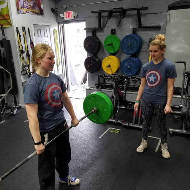 Frisch School athletes train for Underground Training's powerlifting competition on Sunday.