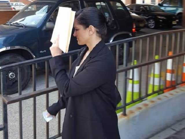 Jennifer Caruso (Cook) leaving Central Municipal Court in Hackensack after her plea bargain.
