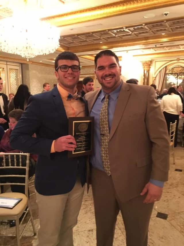 Lyndhurst High School football player Matt DeMarco receives the Brian Piccolo Memorial Award for excellence on the field and in the classroom.