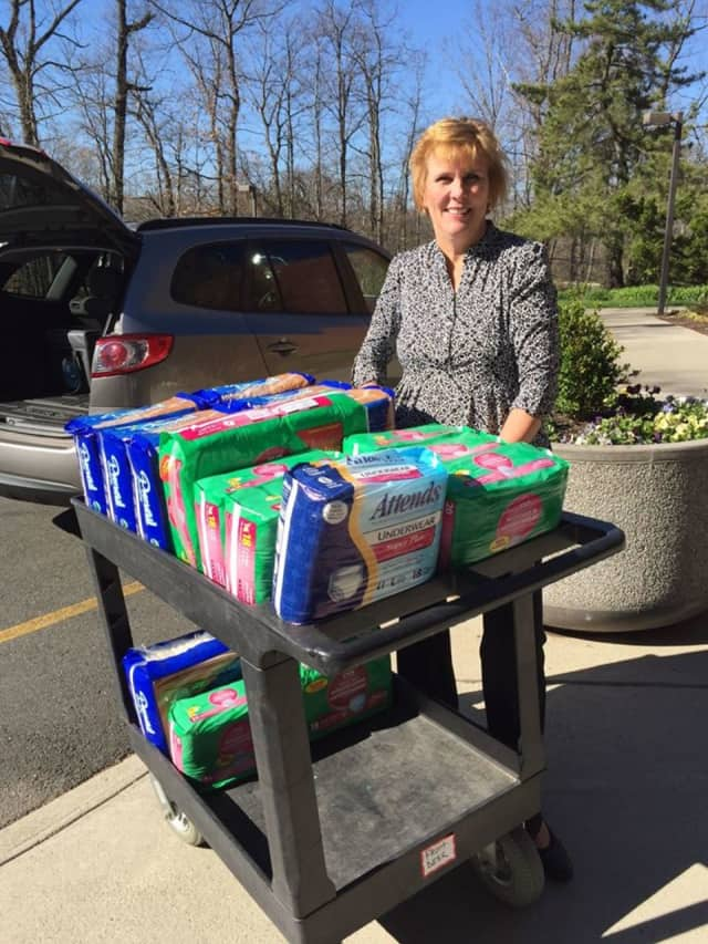 Jeanne picks up absorbent products for her Pascack Valley Meals On Wheels clients. Adult care briefs are being collected at the Bergen County Administration Building in honor of Older Americans Month in May.