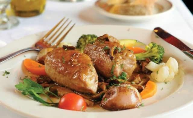 Veal Rolantini at Louie's is stuffed with prosciutto, ,mozzarella in a mushroom demi-glaze.