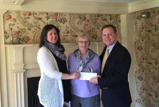 Mayor John Harkins presents a $3,000 check to Carole Adzima, president and executive director of the Perry House Foundation, and Patty Gallagher, treasurer of the foundation.
