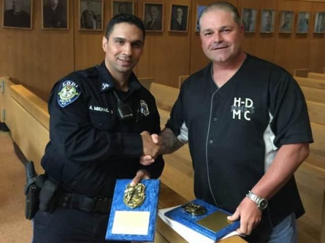 Vincenzo Leto presents award to Lodi Police Officer Andrew Mikhail.