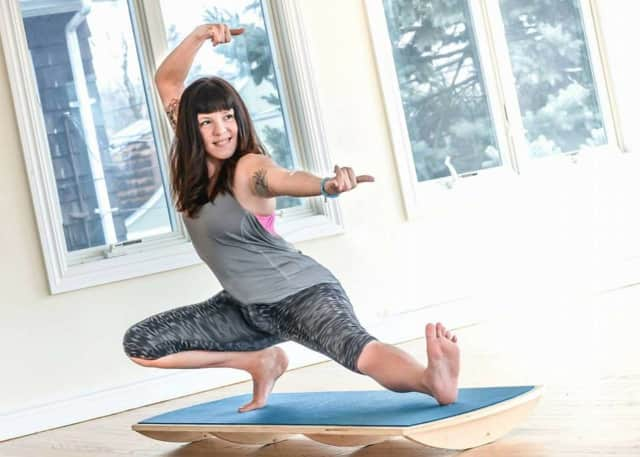 Andrea Powers invented an indoor paddle board for yoga.