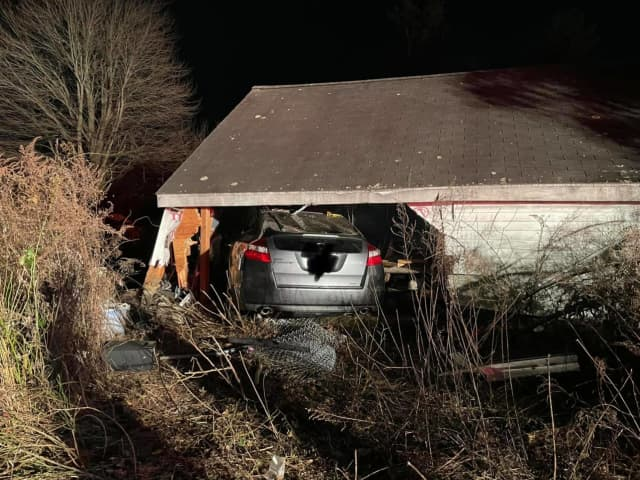 A man who suffered a medical emergency crashed into a garage that then collapsed onto his vehicle.