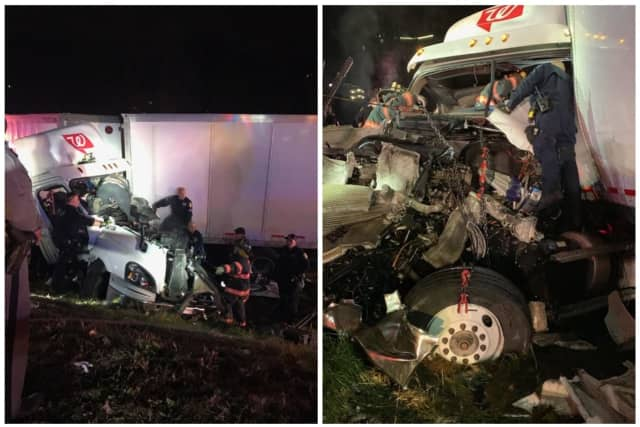 A tractor-trailer driver was injured after crashing into another truck parked on the shoulder of the New York State Thruway in Yonkers.