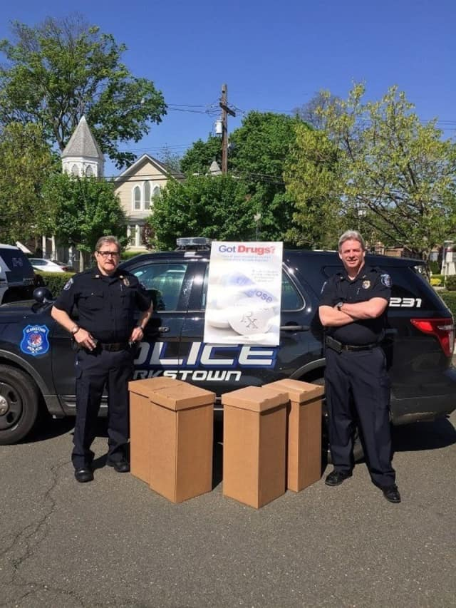 Clarkstown police Captain Robert Mahon and Chief Michael Sullivan with boxes of pills collected in New City and Bardonia during the April 30 Drug Take Back event.