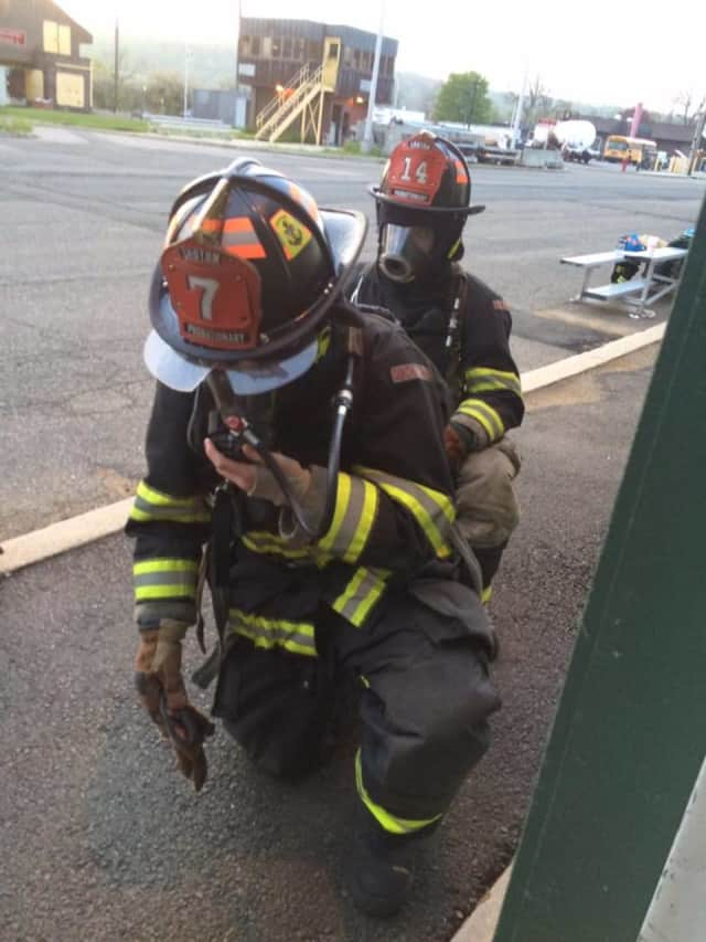 Two members of Washington Engine Co. No. 2 during training.
