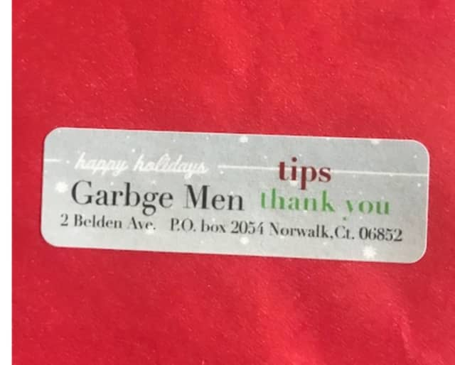 A copy of the envelopes being left in resident's mailboxes asking for tips.