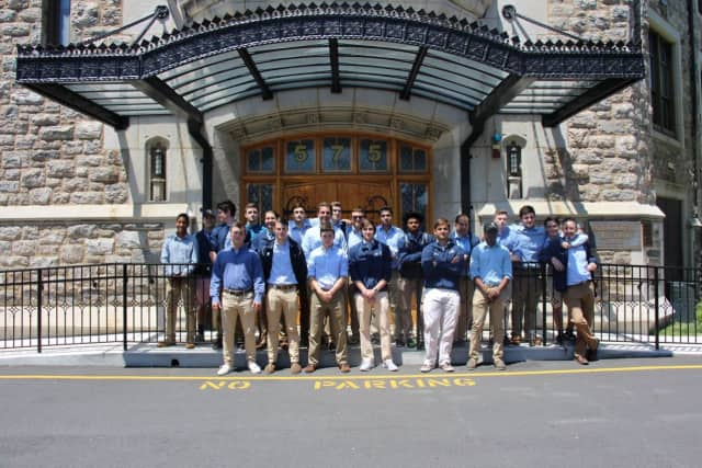Pelham Memorial High School Rugby team poses outside the school.