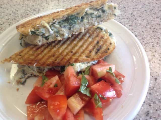 A Lunch Special this week at Crumbs Gourmet Bakery: Fresh Spinach and Artichoke Grilled Cheese with Tomato Basil Salad
