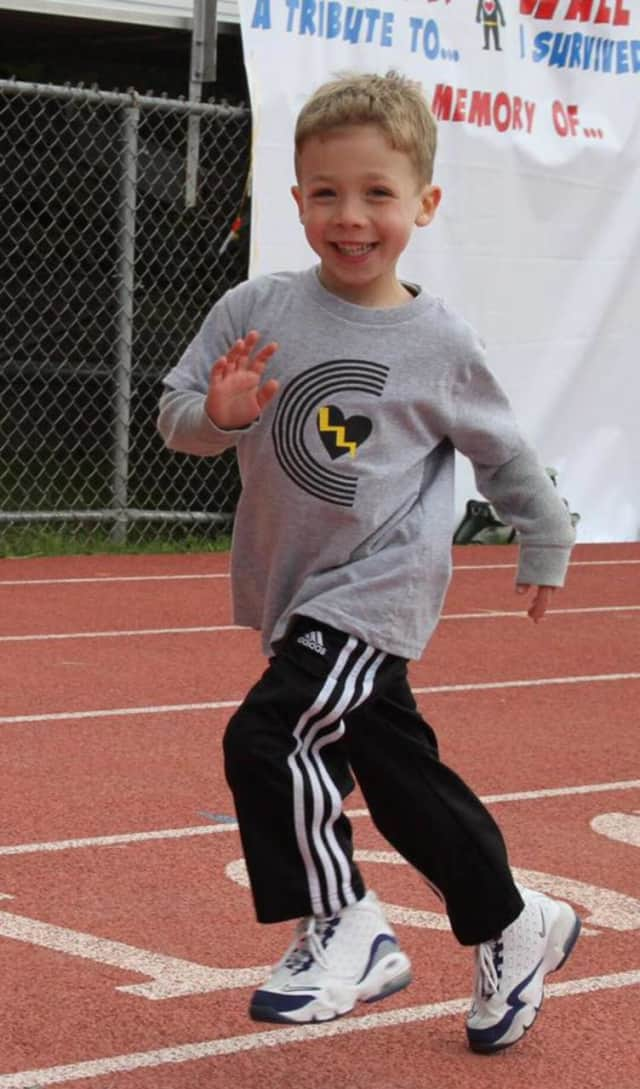 Cooper Palatnek, 5, takes a victory lap around the track at Pascack Valley High School.