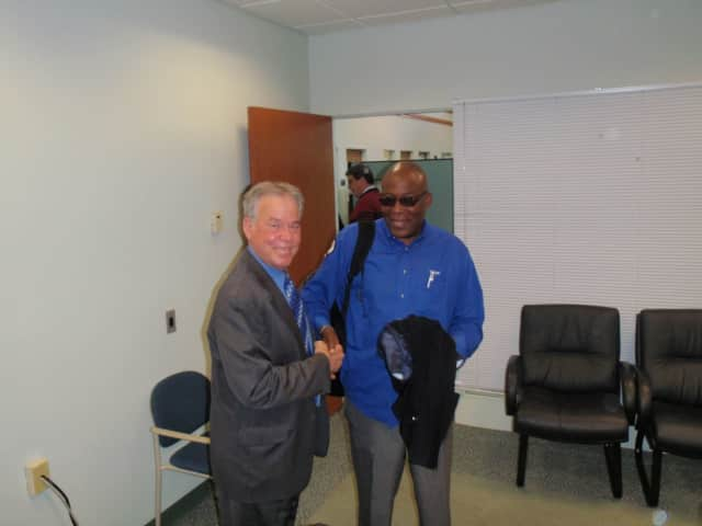 County Executive Ed Day meets with Victor Muscadin of the county Department of Planning and Public Transportation.