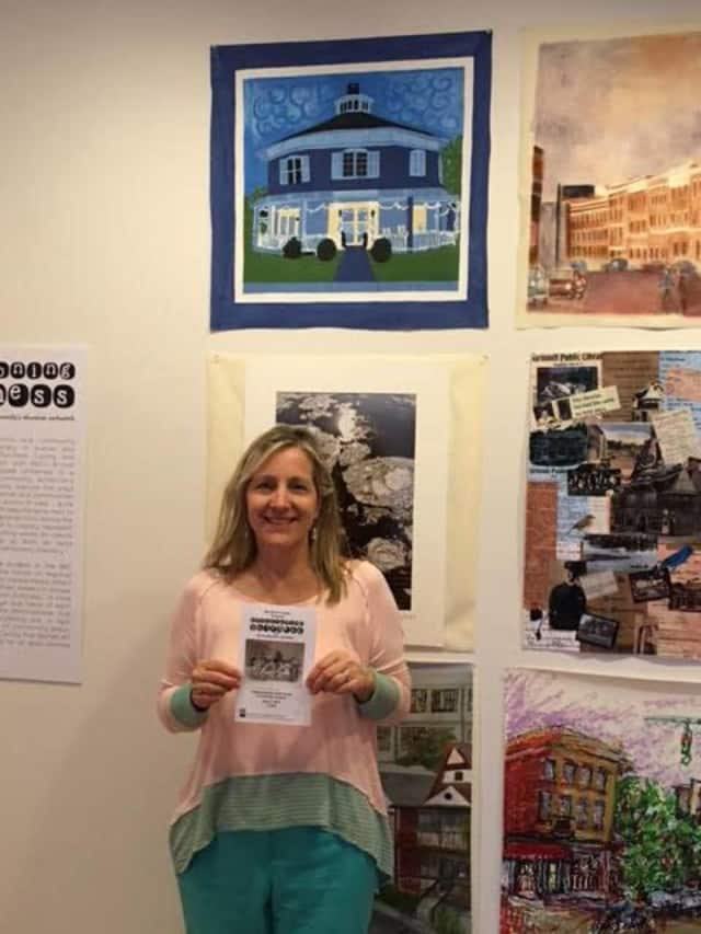 A member of the staff at Red Hook Public Library has her art of the library displayed at the Envisioning Dutchess Exhibition, Barrett Art Center, Poughkeepsie, N.Y.