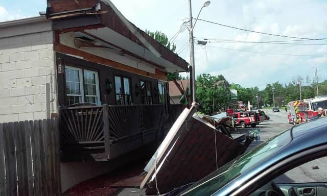 Washington Heights firefighters helped employees and customers get out safely after the awning on a Wallkill beauty salon collapsed Monday afternoon, Time Warner Cable News says.