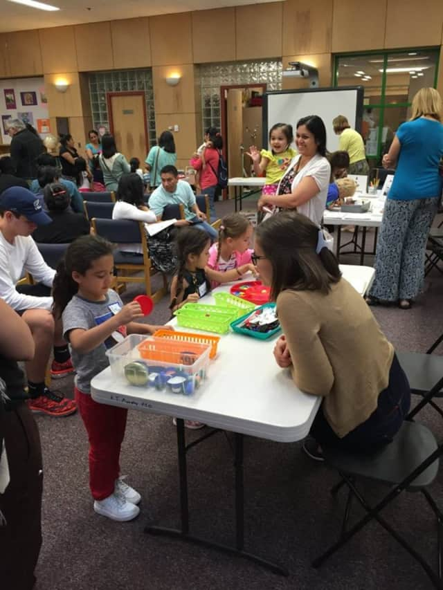 Parents and children attend a recent Play to Learn event.