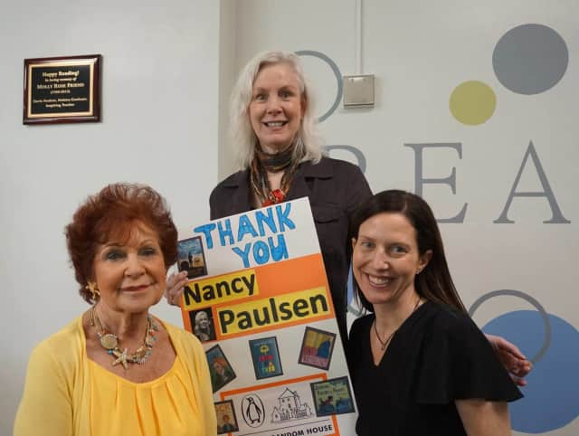 Nancy Paulsen, center, president and publisher of Nancy Paulsen Books, recently donated a 1,000 books to the Davis Library Media Center in New Rochelle.