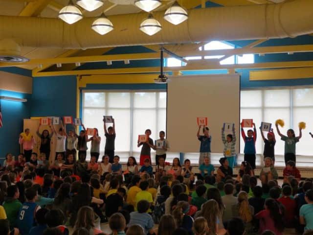 Students at Todd Elementary School in Briarcliff Manor take part in a recent assembly to celebrate the school's Habits of Mind International School of Excellence certification.