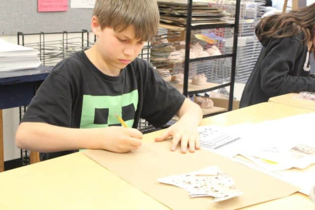 A student designing a canopic jar.