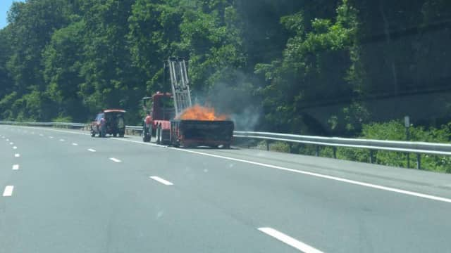 A dumpster caught on fire on I-87.