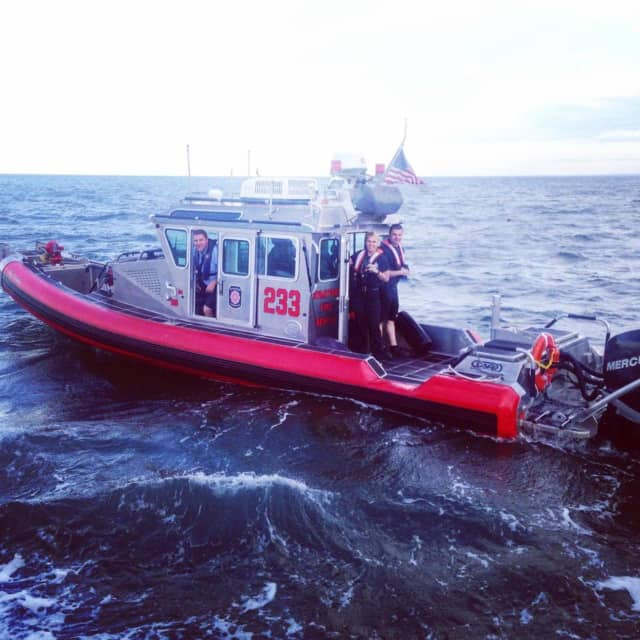 A crew from Stratford Fire Department Marine Unit helps in the search for a missing man in Long Island Sound.