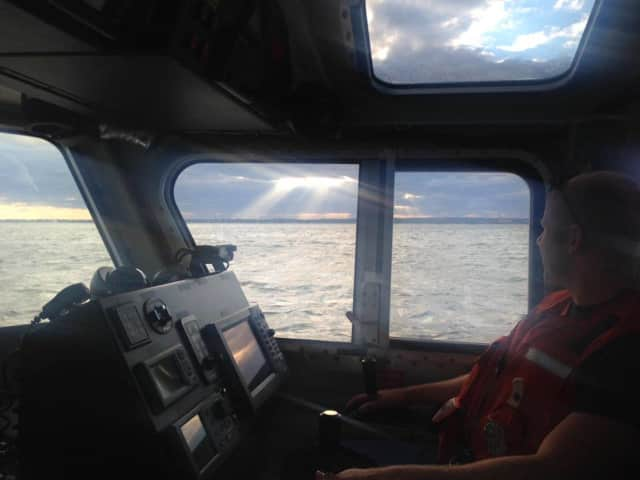 The U.S. Coast Guard continued to look for a man whose raft capsized Sunday afternoon in Bridgeport.
