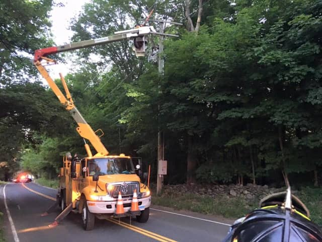 Eversource crews are out making repairs to restore power on Friday.