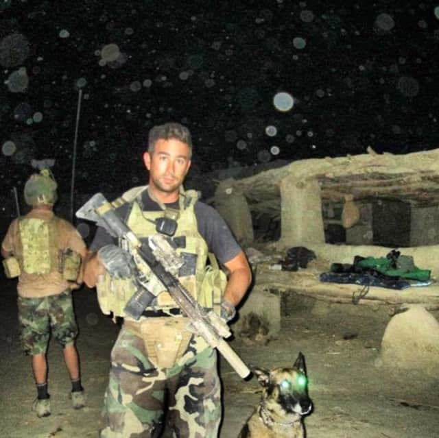 Officer Eric Patenaude and K-9 Harco prior to a night mission during their deployment to Afghanistan in 2012 with the Marines.