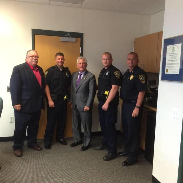 L to R: Commissioner Yost, Officer DePanfilis, Mayor Rilling, Officer Nyquist and Chief Kulhawik