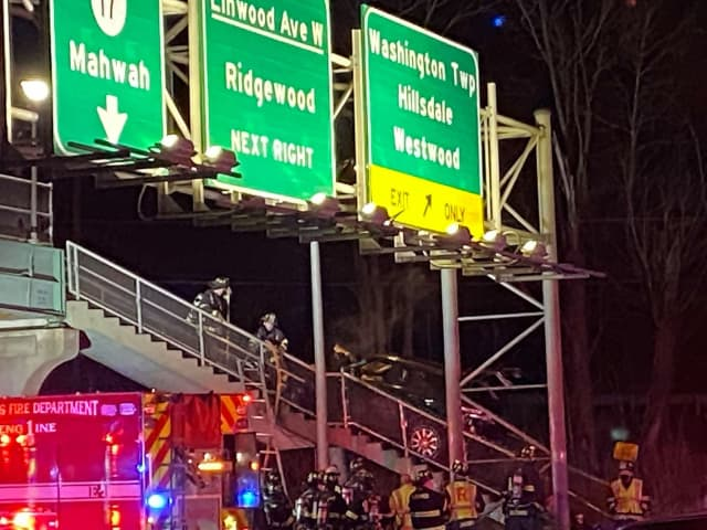 The SUV crashed onto the steps of the pedestrian bridge on Route 17 near Linwood Avenue.