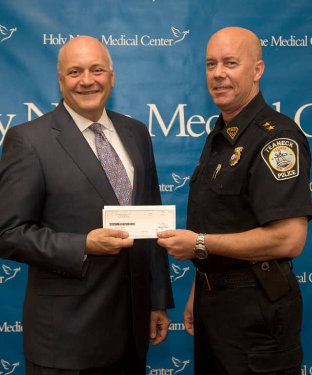 Michael Maron, president and CEO of Holy Name Medical Center with Teaneck Police Chief Robert Carney.