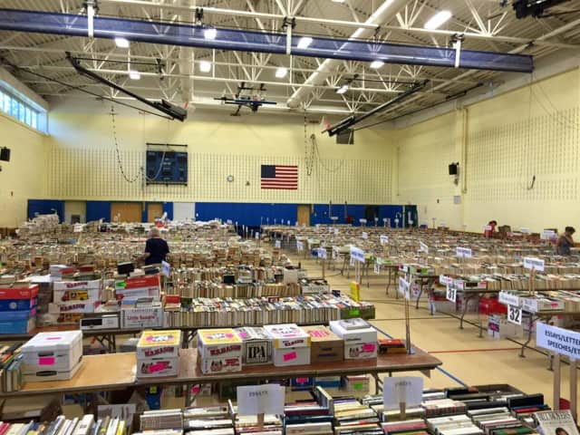 The nonfiction books are sorted for sale at Reed Intermediate School in Newtown. The sale is held by the Friends of the C.H. Booth Library.