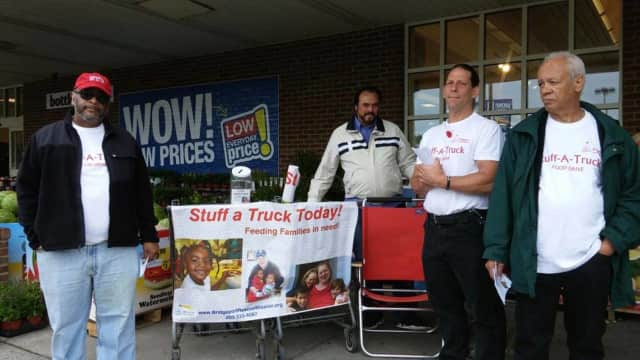 Staff and volunteers for Bridgeport Rescue Mission will be out Saturday to gather food donations at area Stop and Shop stores for the group's Stuff-A-Truck food drive.