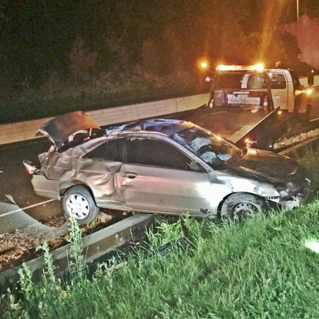 Members of Trumbull's Long Hill Fire Department responded to a single-car collision with injuries on the Merritt Parkway Tuesday night.