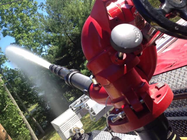 A dry hydrant being tested by firefighters.