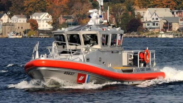 Coast Guard members helped rescue four people after their boat capsized.