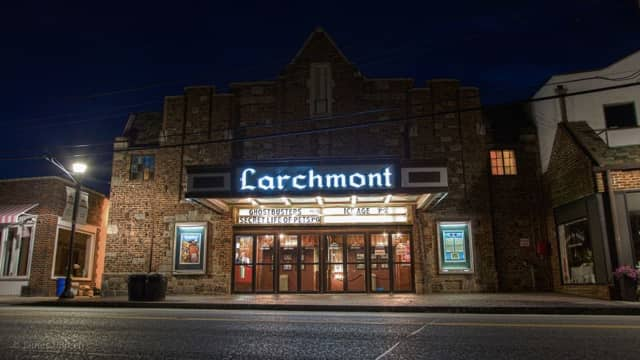 The Larchmont Playhouse lit up at night before it closed.