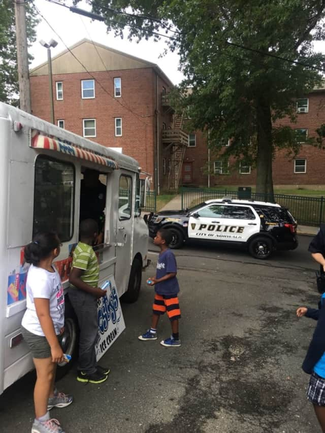 Kids from the Roodner Court Learning Center cool off.