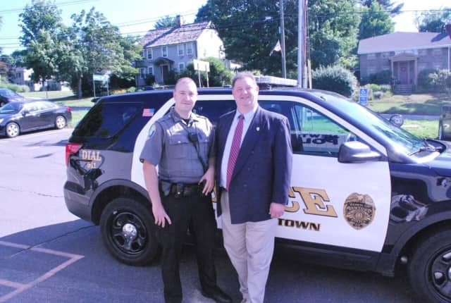 Officer Matthew Hayes meets Rep. Bolinsky with the Ford SUV they will patrol in.