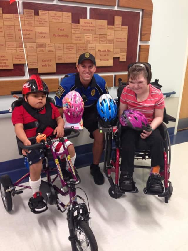 Officer Edwards with two members of the St. Vincent's Special Needs community.